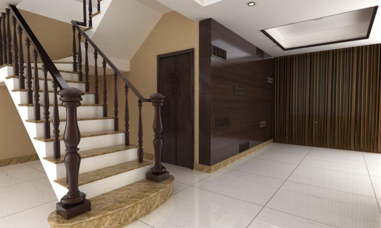 Wnętrze posprzątanego hotelu - widoczne schody prowadzące na górę